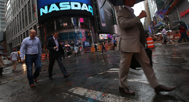 NEW YORK, NY - AUGUST 22:  People walk past the NASDAQ MarketSite in Times Square after trading was halted on all Nasdaq-listed stocks on August 22, 2013 in New York City.  A technical glitch caused all Nasdaq stock trading to be halted this afternoon.  (Photo by Mario Tama/Getty Images)